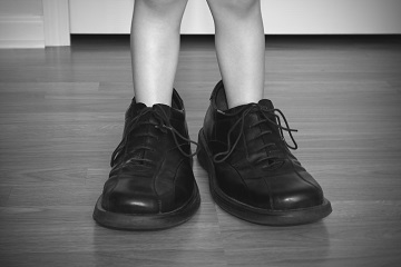 Toddler Wearing Adult Shoes