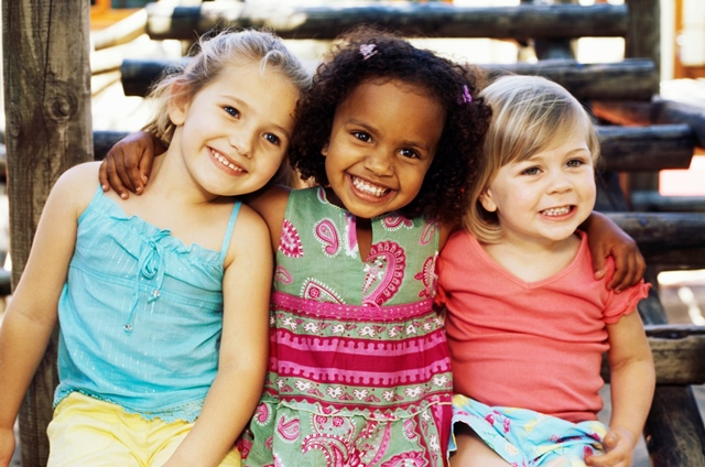 Close-up of  three girls  sitting and smiling